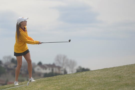 Windsor golfer Sarah Johnson watches a chip shot at the Tri-Valley League match at TPC Colorado in Berthoud on Monday, April 15. The Wizards are the defending 4A champions and host state May 20-21 at Pelican Lakes Golf Course.