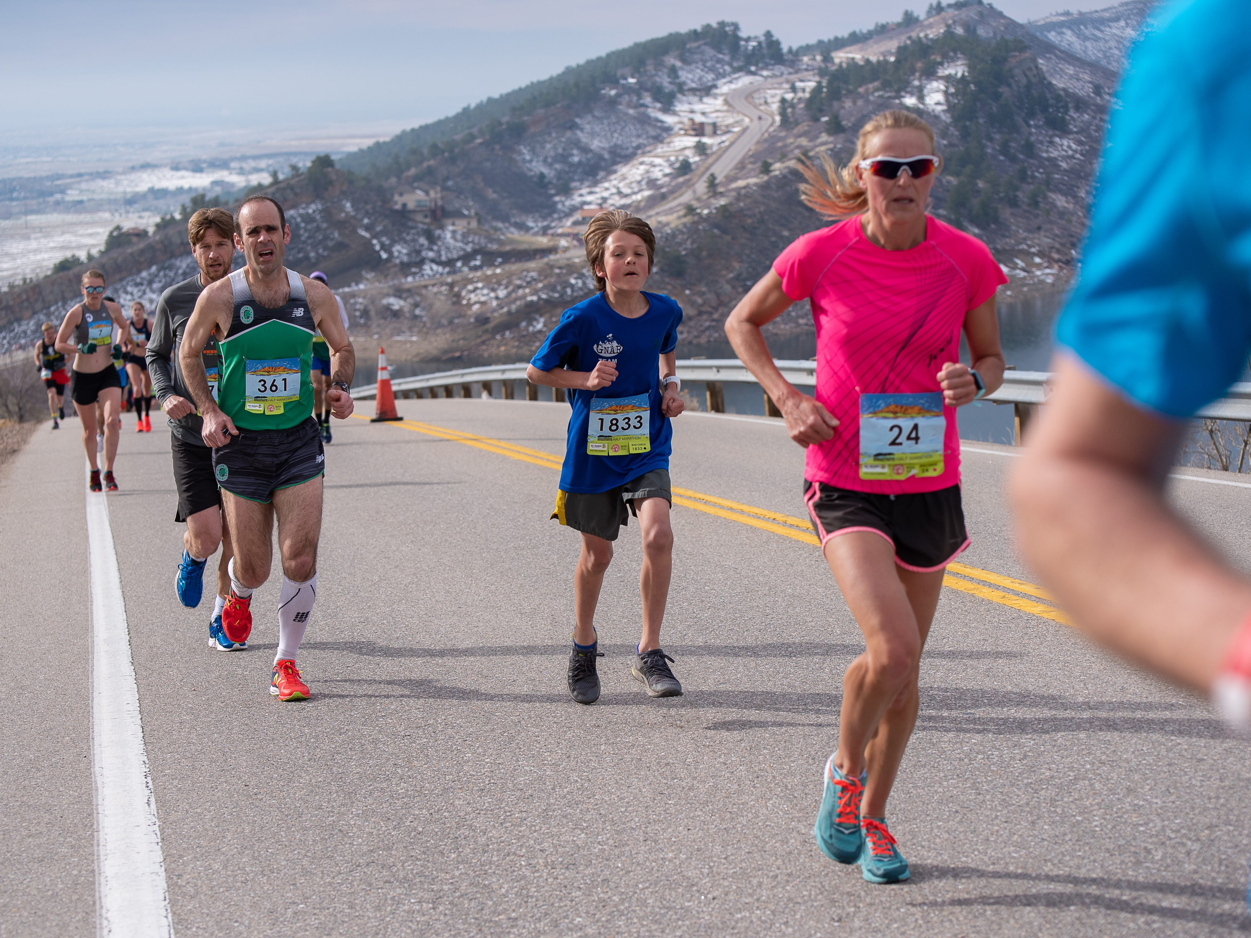 Alistair Clark, 12, finished 58th in the Horsetooth Half Marathon on Sunday. Elite runners approach the top of Monster Mountain along Horsetooth Reservoir during the Horsetooth Half Marathon on Sunday, April 14 2019, in Fort Collins, Colo.