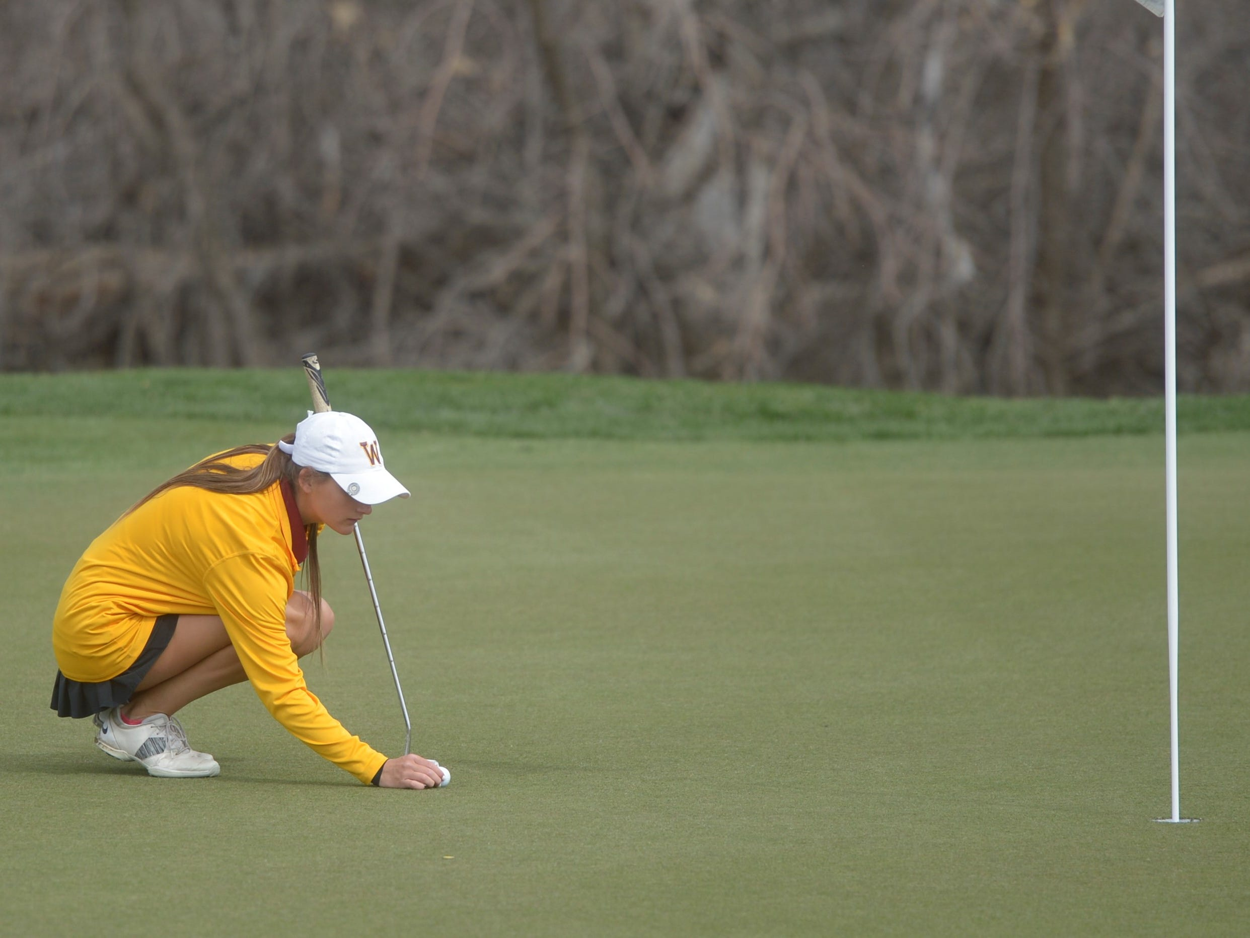 Windsor golfer Sarah Johnson places her ball at the Tri-Valley League match at TPC Colorado in Berthoud on Monday, April 15. Windsor won the event. It's the first Tournament Players Club course in the state.