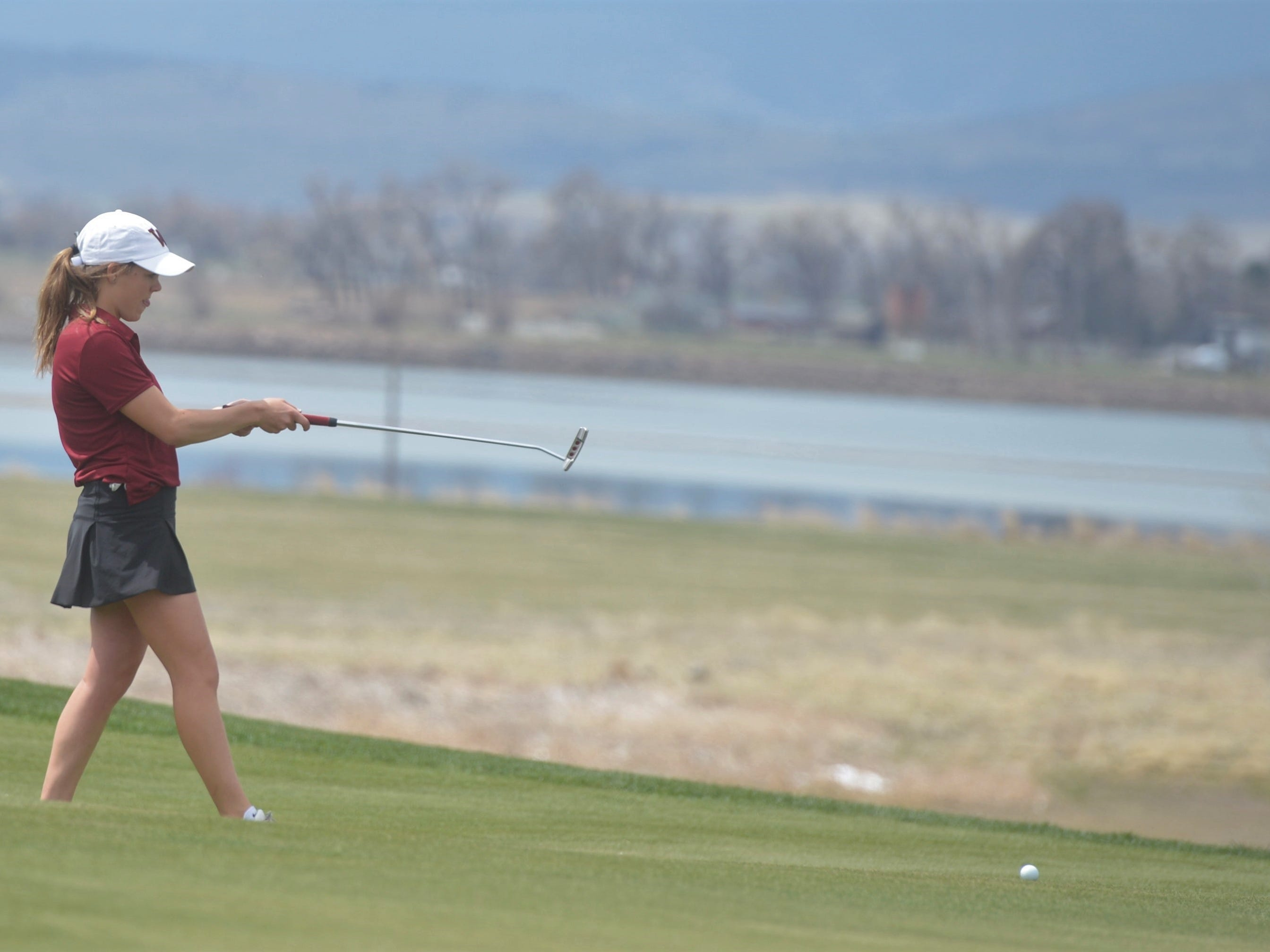 Windsor golfer Jessica Zapf lines up a putt at the Tri-Valley League match at TPC Colorado in Berthoud on Monday, April 15. Windsor won the event. It's the first Tournament Players Club course in the state.