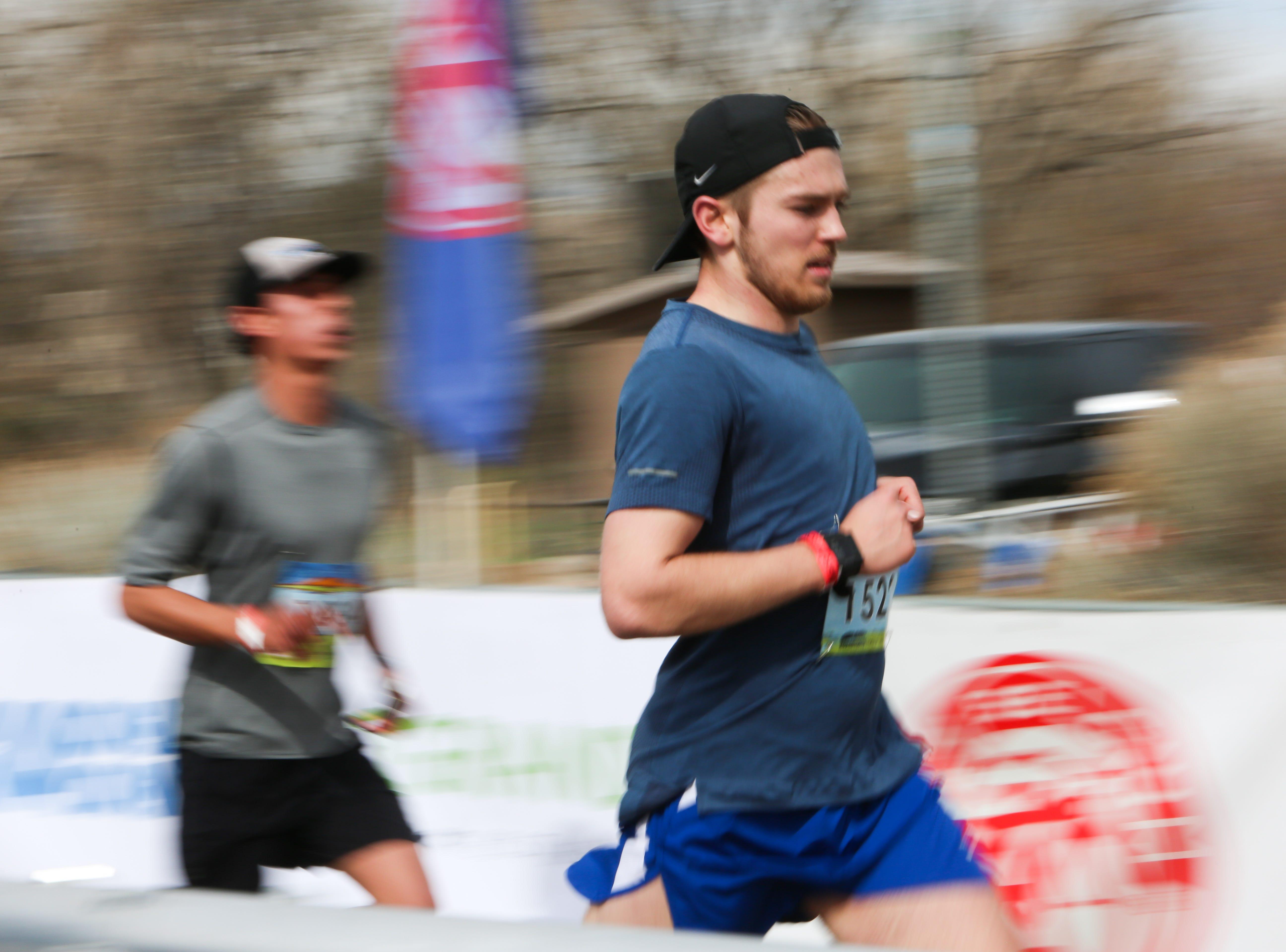 Runners finish the Half Marathon at New Belgium on April 14.