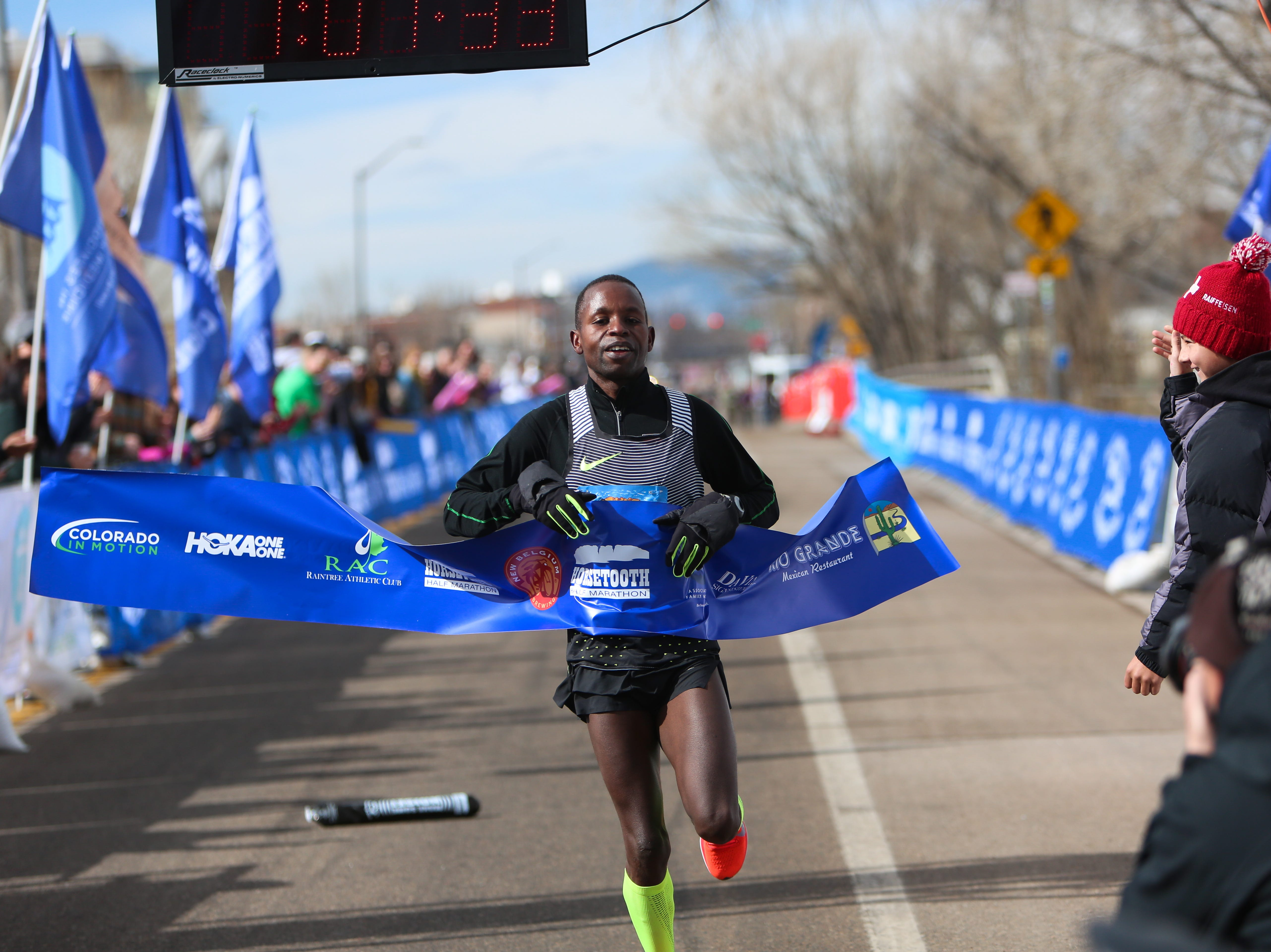 Dominic Korir finishes first in the Horsetooth Half Marathon on April 14.