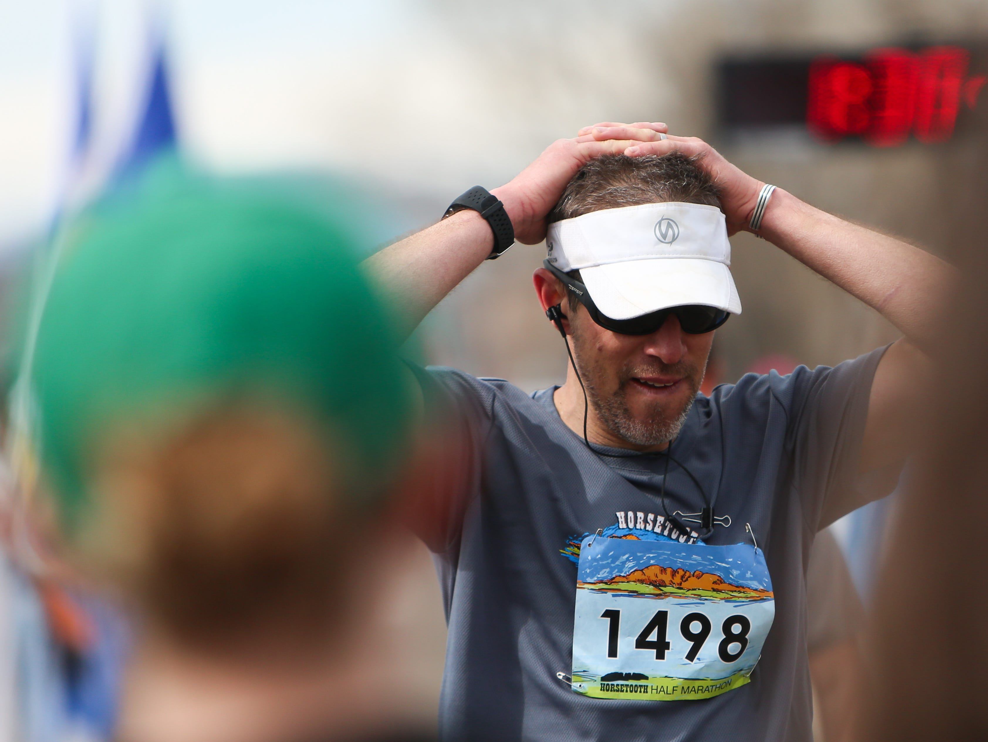 Micah Whitman catches his breath after finishing the Half Marathon.