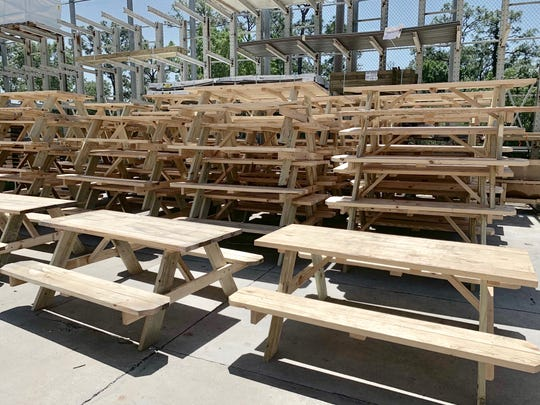 More tables were donated Monday by Lowe's home improvement stores in the Southwest Florida district. Seventy-five were built and stored at the Gladiolus store and another 25 were to be delivered.