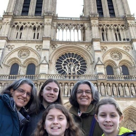 Back row, from left, Green Bay area residents Denise Dauplaise, Mallory Eisenreich and Renee Dauplaise. Front row, from left, Brigid and Tatum Eisenreich, in front of Notre Dame Cathedral in Paris Monday morning, hours before the historic church burned.