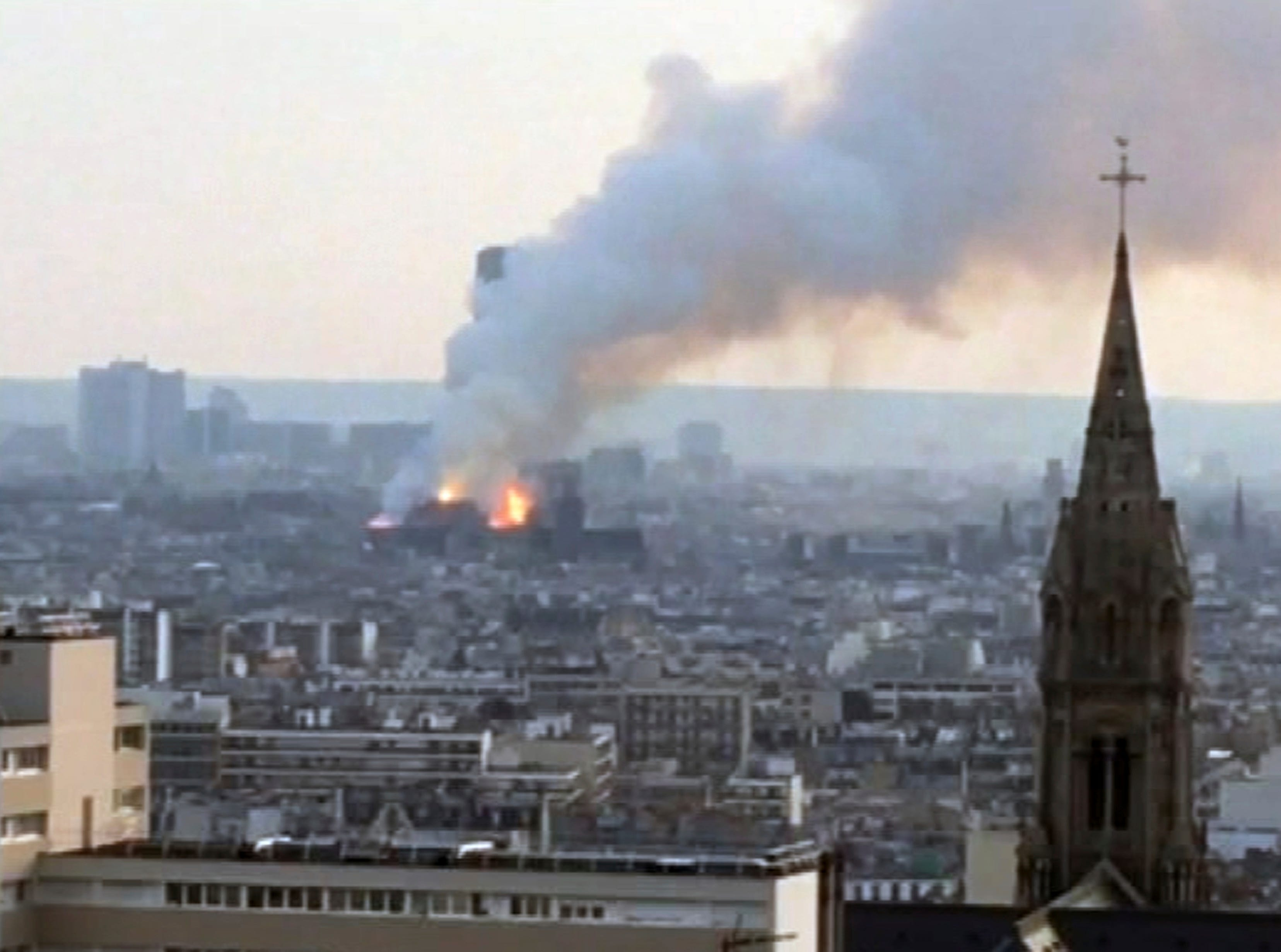 Plumes of smoke rises from Notre Dame cathedral burning in Paris, Monday, April 15, 2019.  Massive plumes of smoke fills the air above Notre Dame Cathedral and ash is reported to be falling on tourists and others around the island that marks the center of Paris. (AP Photo)