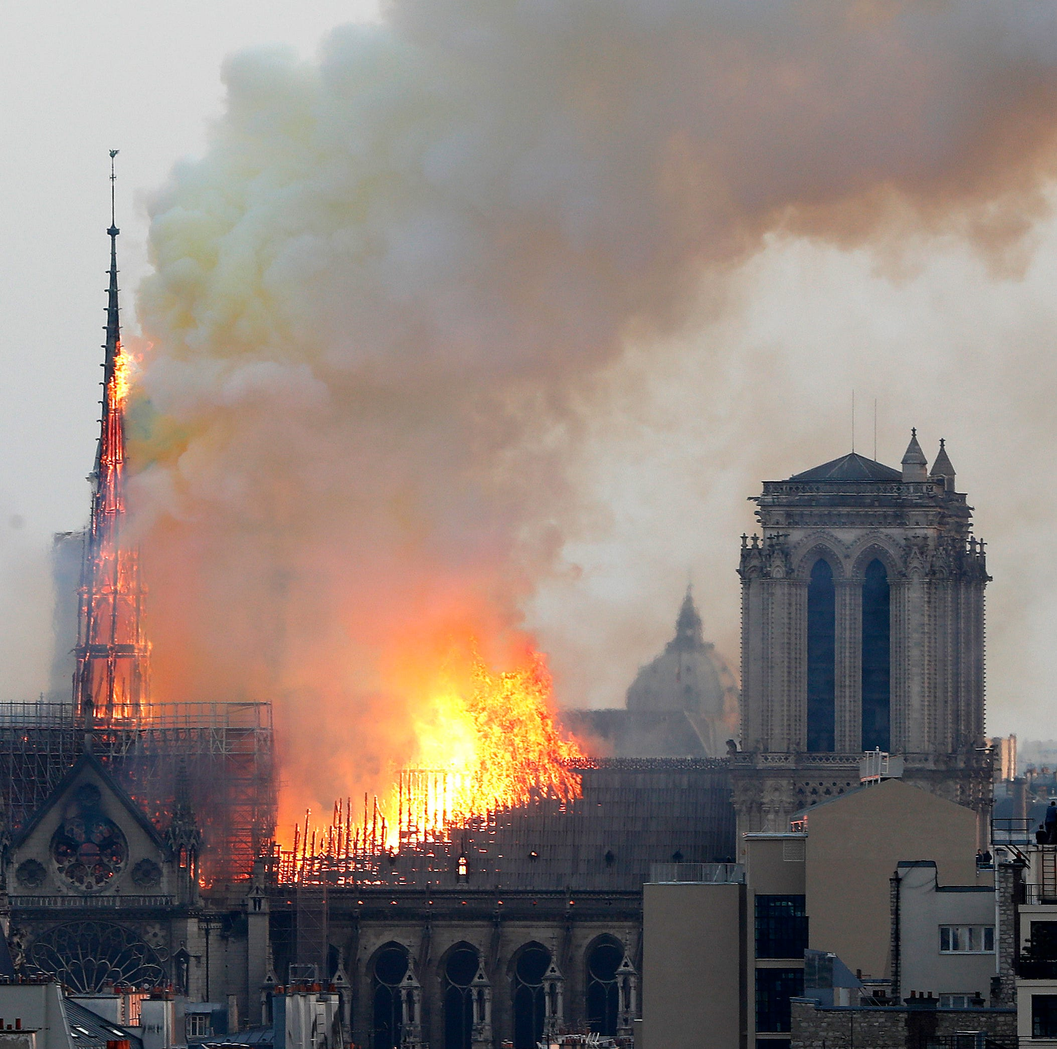 Notre Dame fire: Part of the spire of iconic Cathedral in Paris has collapsed amid a raging fire