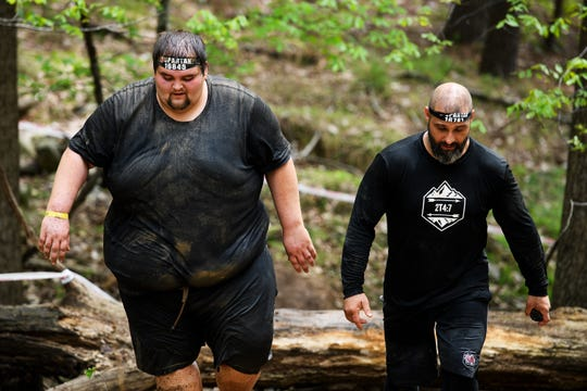 "David ""D.J."" Maynard and Joe Tessari walk up a hill during the Spartan race in Buford Saturday, April 13, 2019."