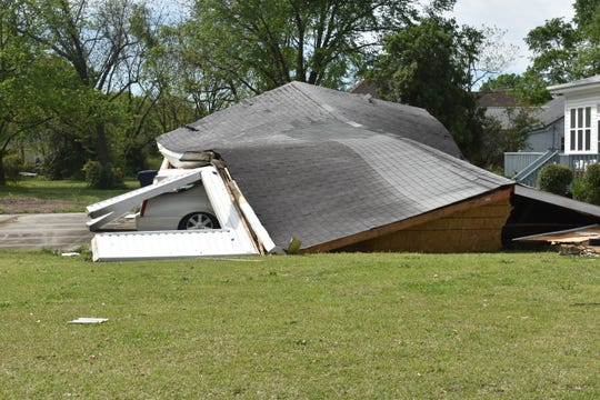 Part of a building collapsed on top of a car in Simpsonville after storms ripped through the area Sunday night.