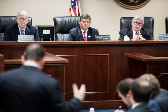 Public Service Commission chairman Comer Randall, right, Swain Whitfield, and Tom Ervin, left listen to an opening statement during the first day of the PSC trial into SCE&G's rates following the V.C. Summer nuclear debacle on Nov. 1, 2018, in Columbia, S.C.