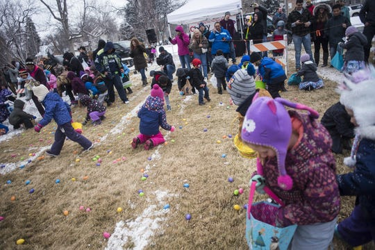 In this 2018 file photo, participants rush to gather eggs during the Easter Egg Hunt at Gibson Park.