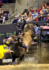 """Cody Teel of Texas won the Professional Bull Riders' Billings Invitational on Sunday with this 86.75-point ride aboard a bull called """"After Midnight."""""""