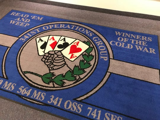 "A carpet at the Malmstrom Museum celebrates victory in the Cold War and the nuclear missiles, which President John F. Kennedy called his ""ace in the hole."""