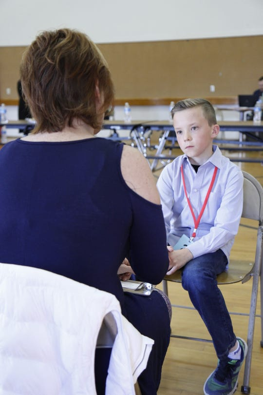 Second place winner Conrad Schruth shows his listening skills during his conversation with Commissioner Tracy Houck.