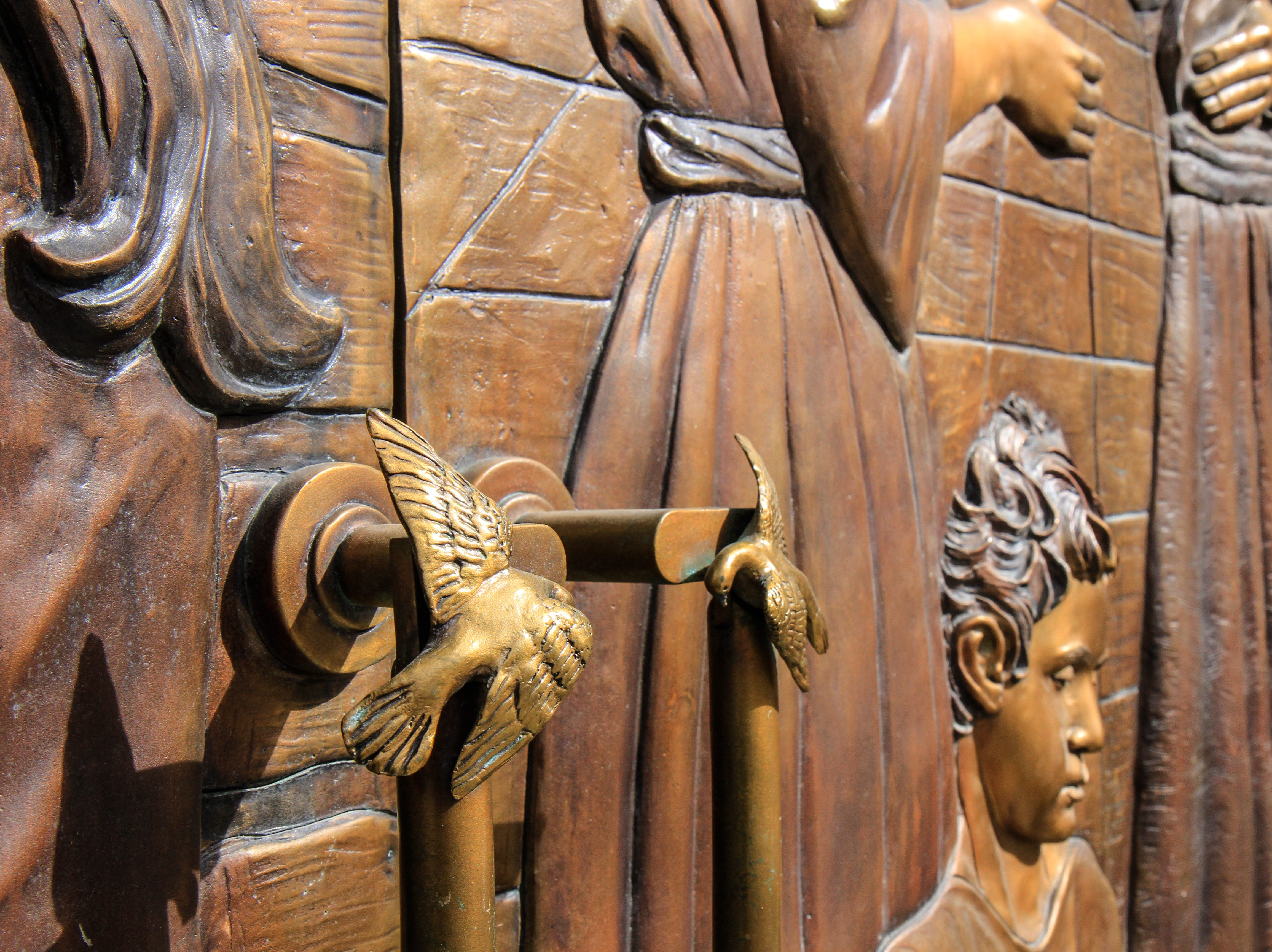 Doves are on the handles of ceremonial doors at St. Ann's Cathedral in Great Falls.