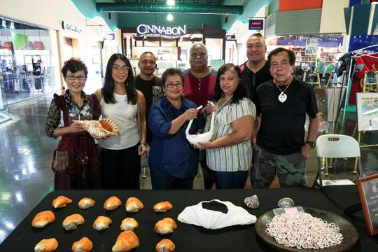 CAHA Arts and Crafts during Mes CHamoru celebration on March 30 at Guam Premier Outlets. Pictured from left: Yeon Sook Park (artist), Brea Bailey (CAHA), Jackie Balbas (CAHA), Angie Taitague (CAHA), Master Carver Greg Pangelinan. Back row: John Taitague, Paul Cruz (CAHA) and Richard Cruz (artist).