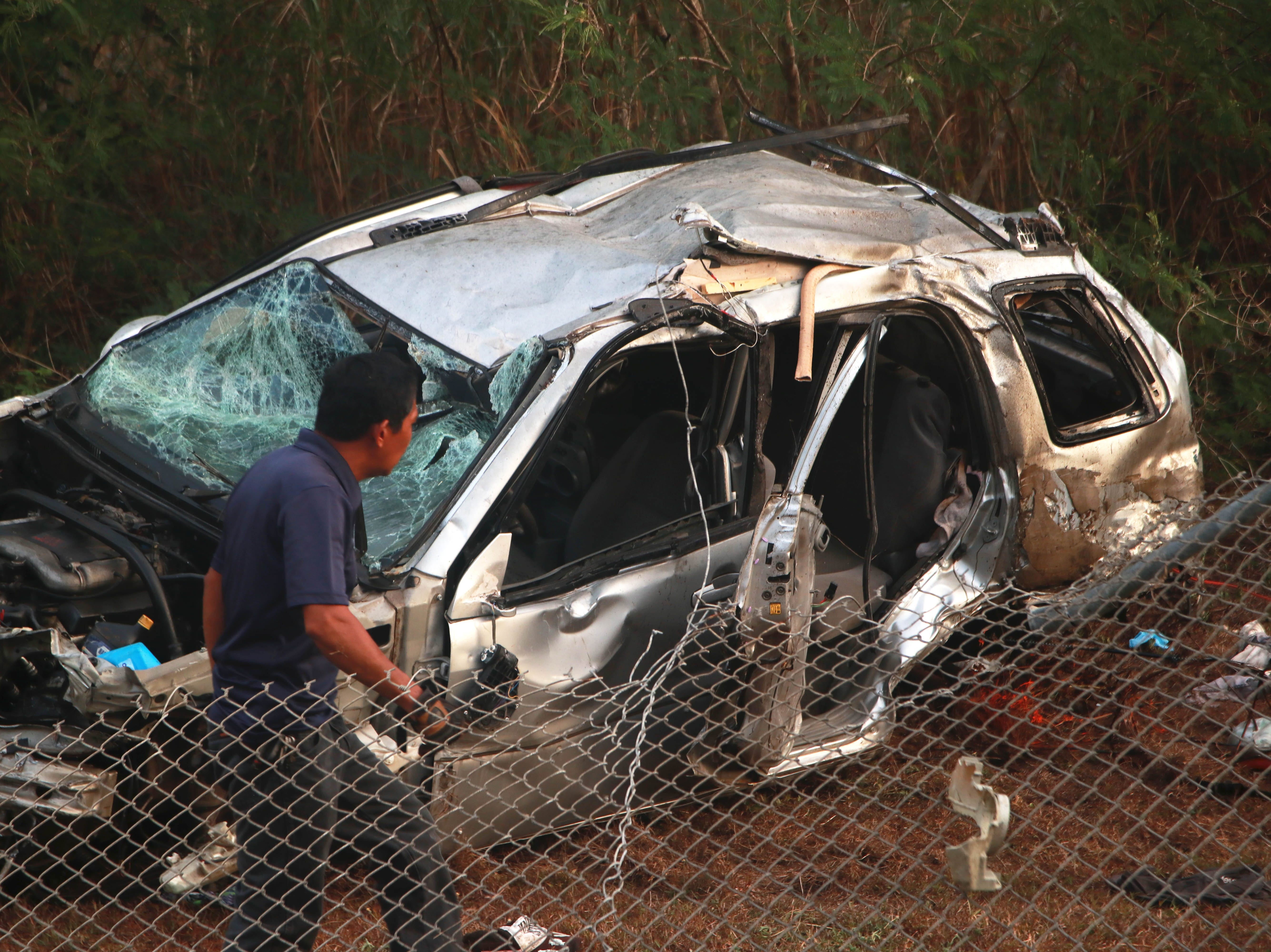 Police prepare to tow an SUV involved in a fatal accident early Tuesday morning on April 16, 2019 near the entrance to Agat.