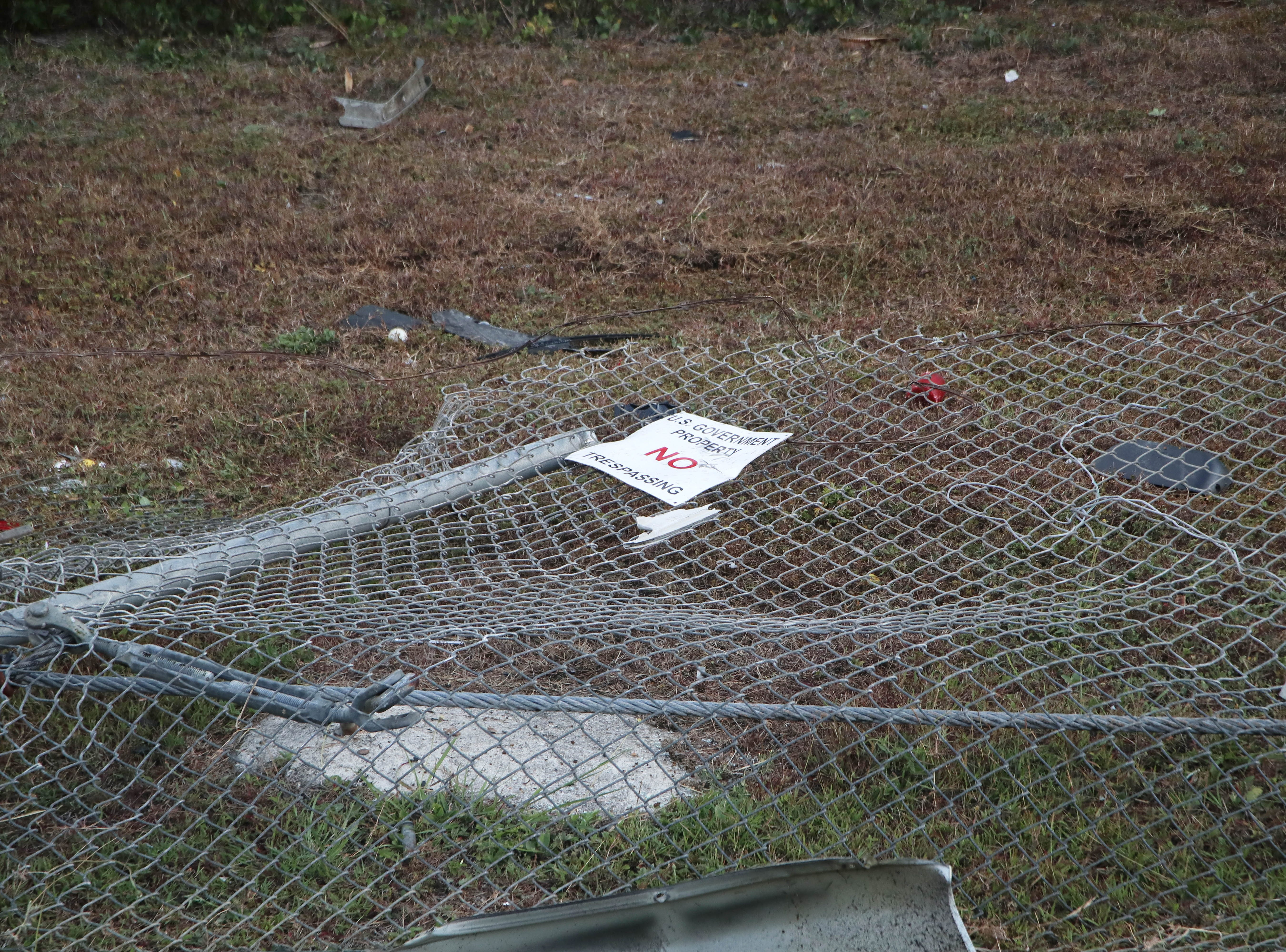 The fatal Agat car accident left part of a barbed wire fence flattened against the ground on Tuesday, April 16, 2019.