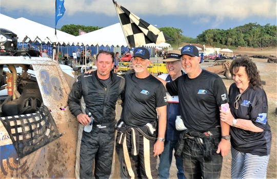 The Triple J Racing team drivers with mom and dad after the 4-hour enduro at the 39th Annual APL Smokin' Wheels at the Guam International Raceway. From left, they are driver Rick Johnson, driver Jeff Jones, Robert Jones, driver Jay Jones, and Margaret Jones.