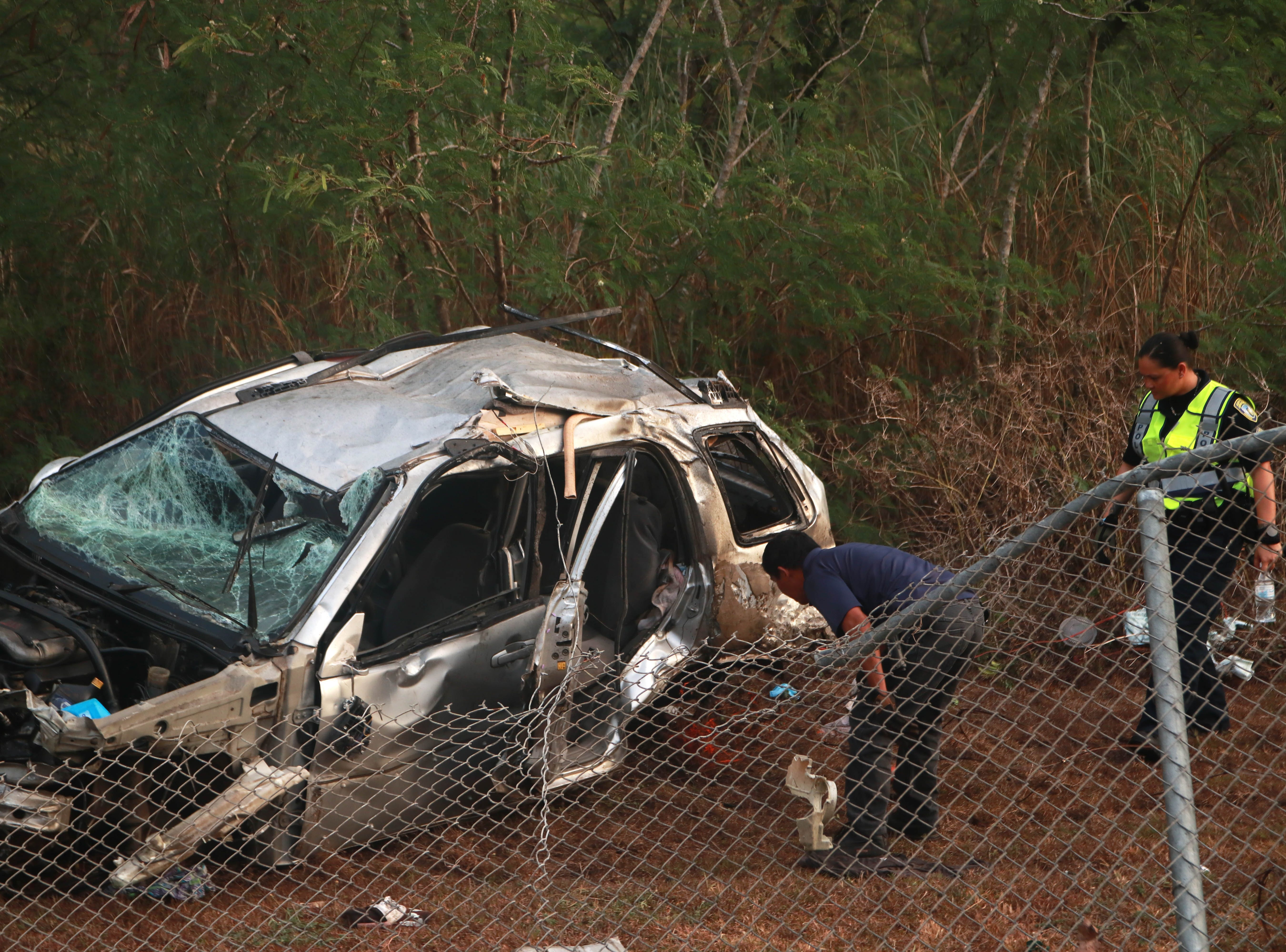 Police examine an SUV involved in a fatal accident early Tuesday morning on April 16, 2019 near the entrance to Agat.
