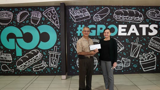 The Guam Premier Outlets donated $250 on April 9 to the St. Francis Catholic School Parent Teacher Alumni Organization. The donation will assist the school in much needed gymnasium renovations. Pictured: David Okada, St. Francis Catholic School Parent-Alumni Organization and Suzanne Perez, GPO director of marketing and operations.