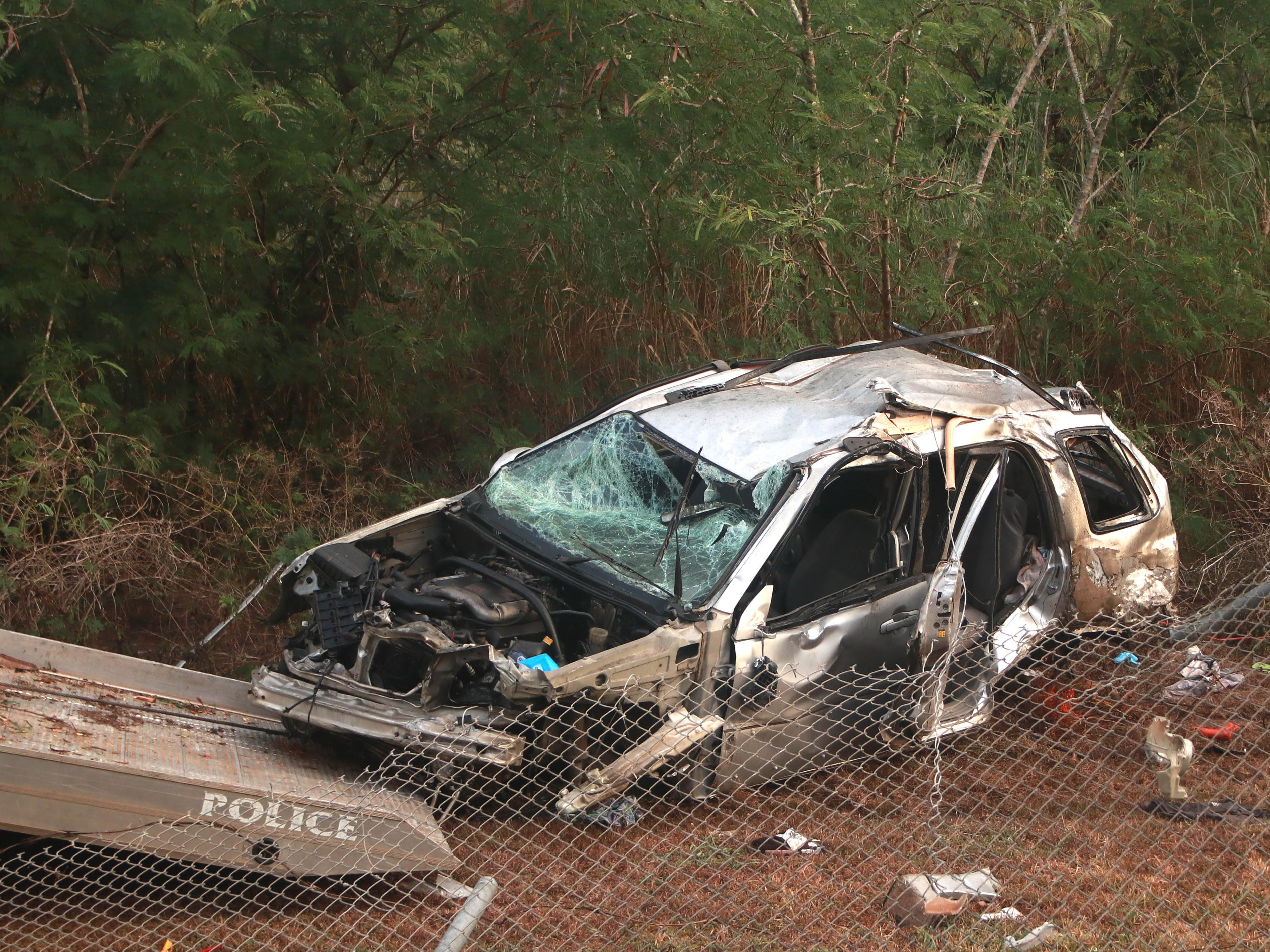 The mangled silver SUV involved in a fatal car accident near the entrance to Agat on Tuesday, APril 16, 2019.