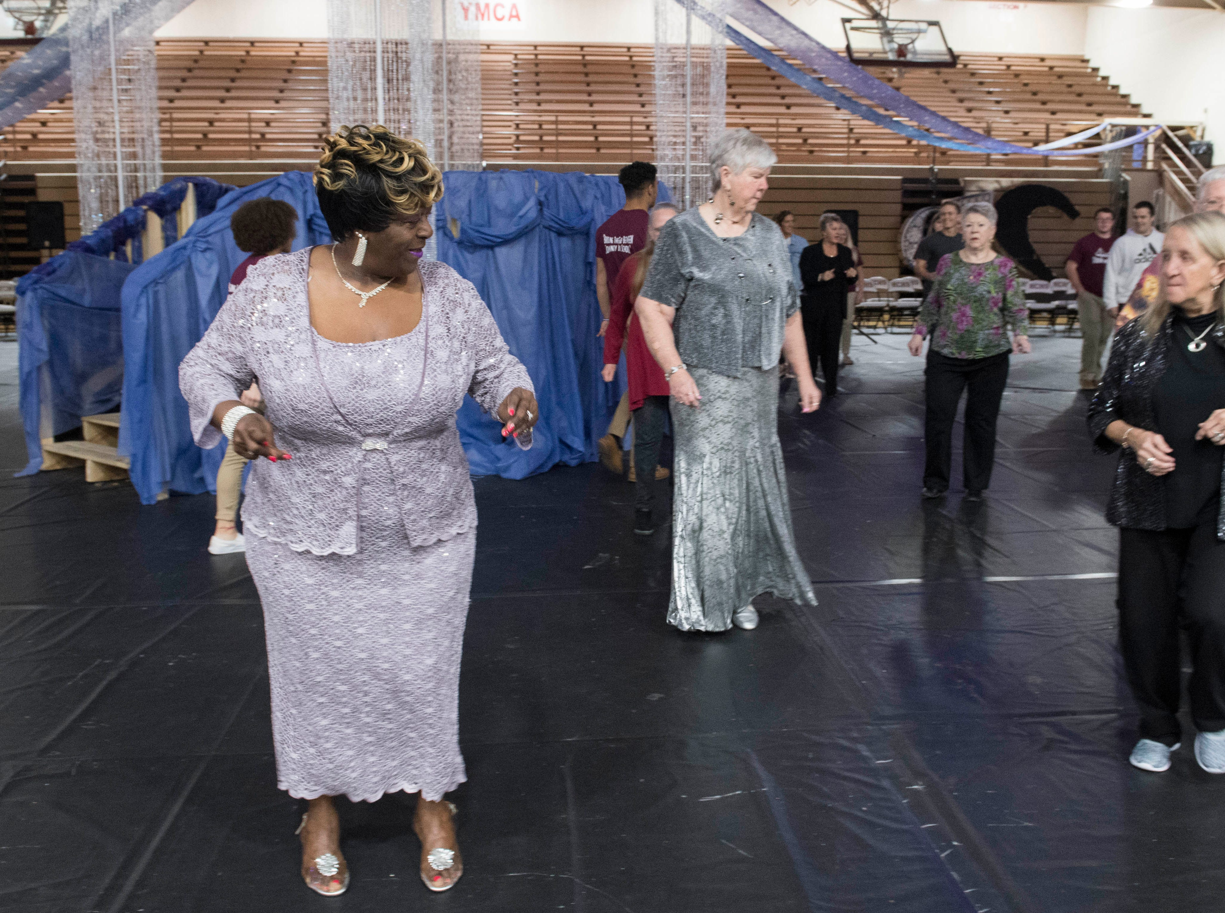 Dorothy Black makes moves on the dance floor during the 2019 Senior Citizen Prom at Henderson County High School Monday, April 15, 2019.