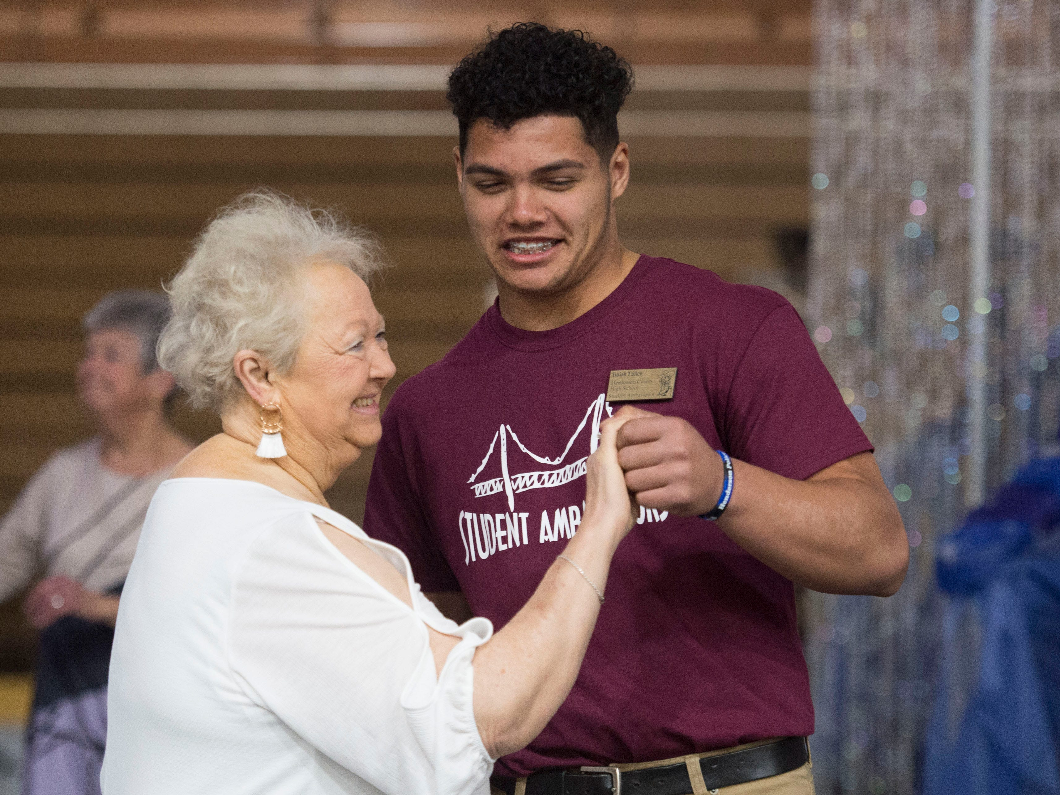 Henderson County High School student Isaiah Fallen, left, dances with Judy Graham, right, during the 2019 Senior Citizen Prom Monday, April 15, 2019.