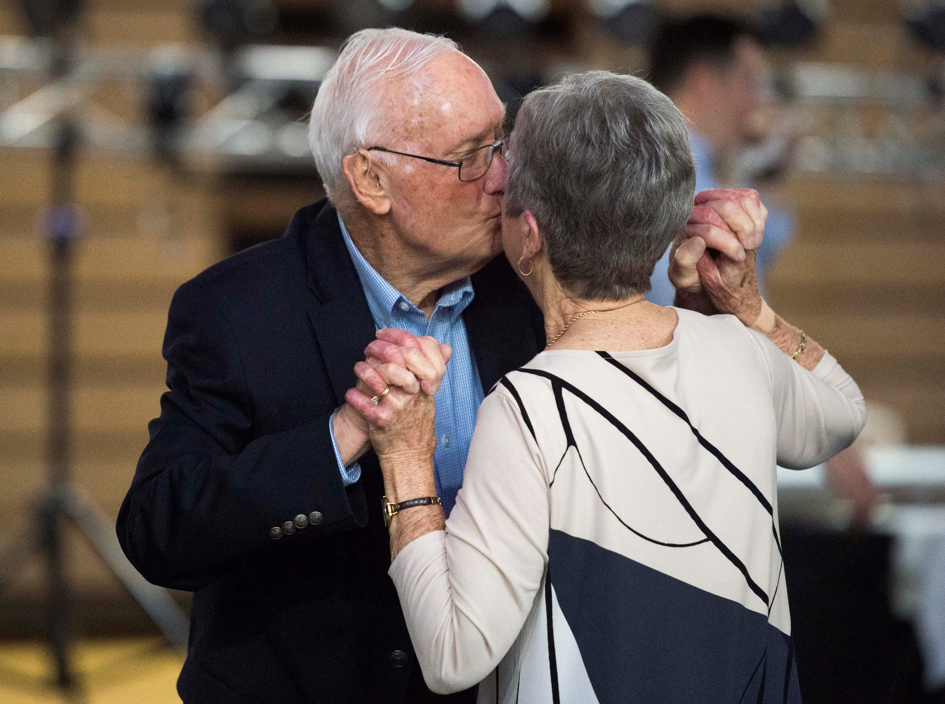 Harry Bennett gives his wife Sui a kiss while on the dance floor during the 2019 Senior Citizen Prom at Henderson County High School Monday, April 15, 2019.