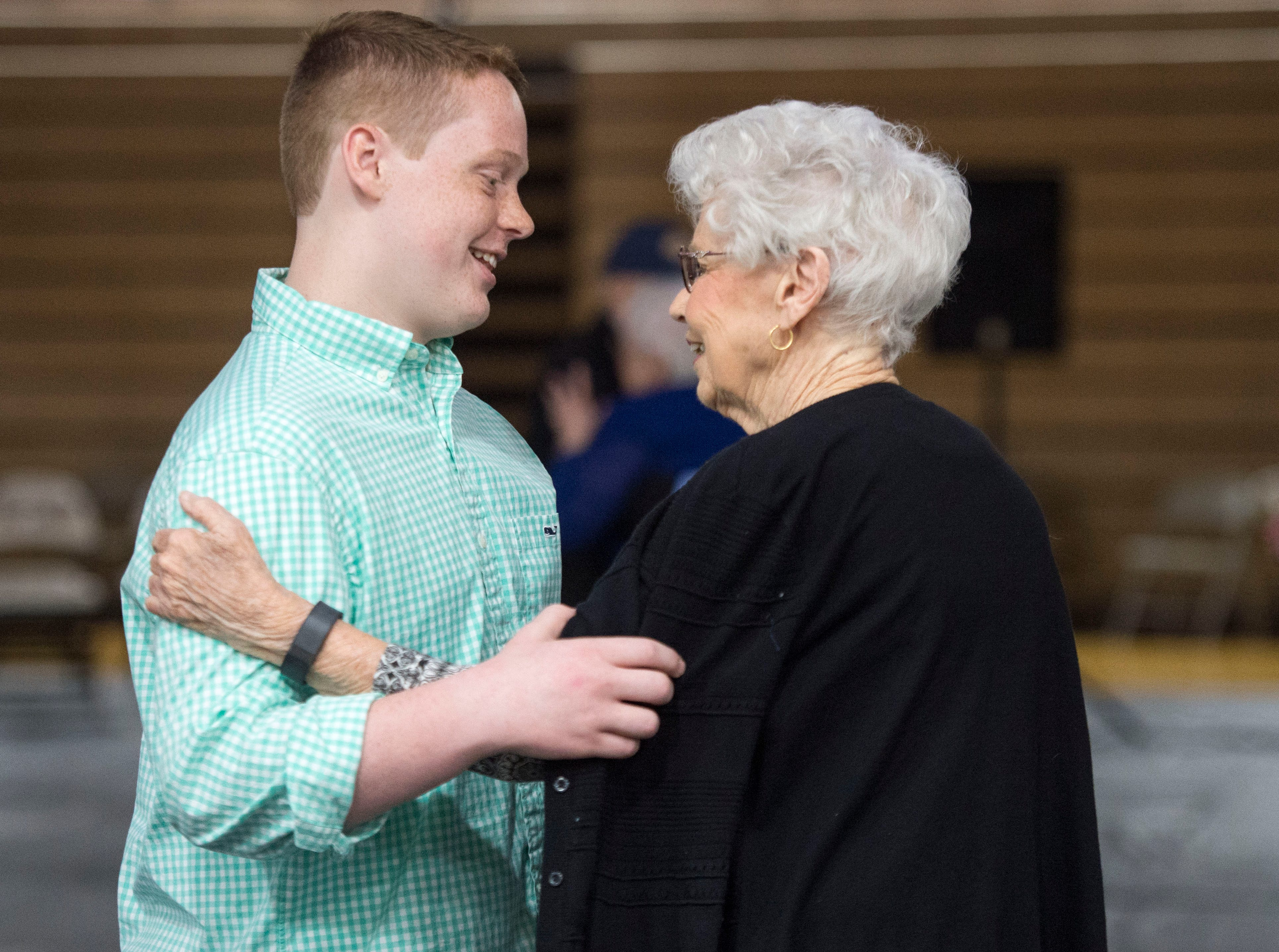 Henderson County High School Freshman Will Forker, left, dances with Dayadre Daybolt, right, during the 2019 Senior Citizen Prom Monday, April 15, 2019.