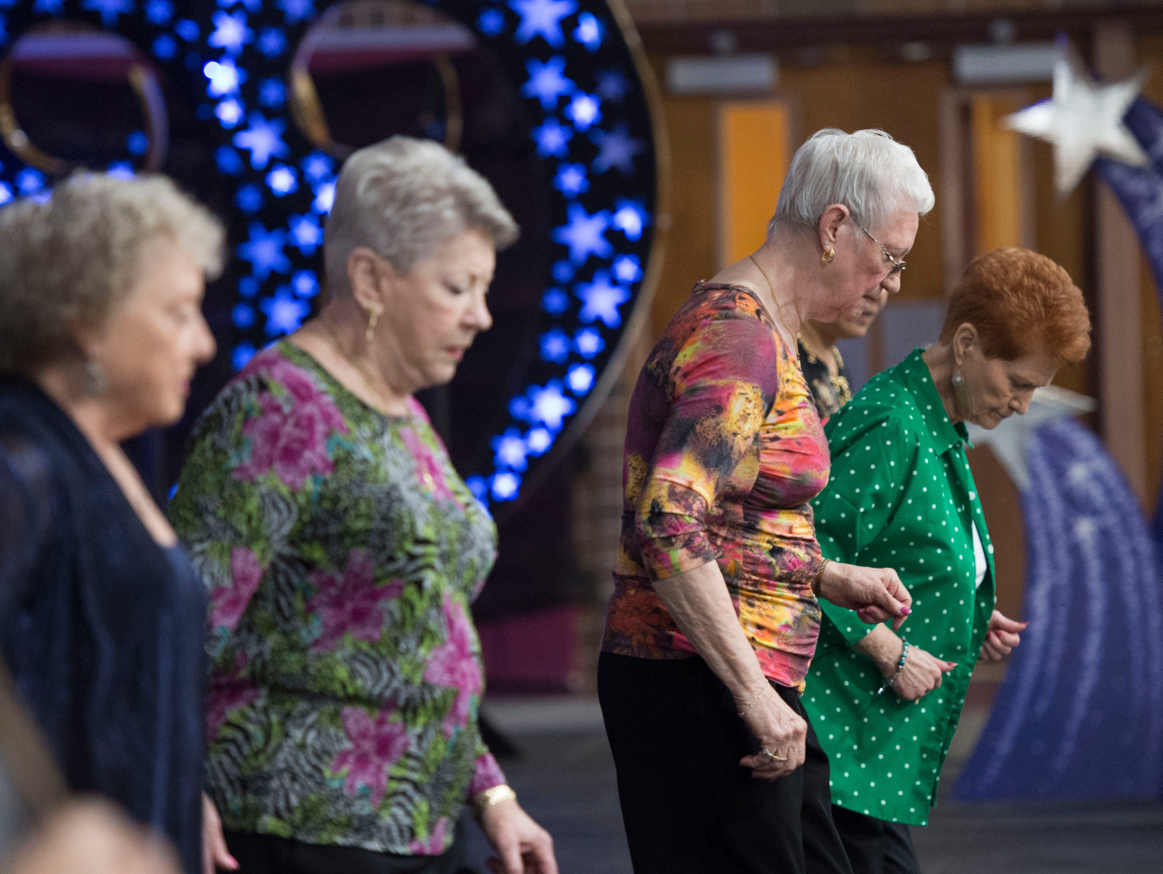 Participants of the 2019 Henderson County High School Senior Citizen Prom do a line dance Monday, April 15, 2019.