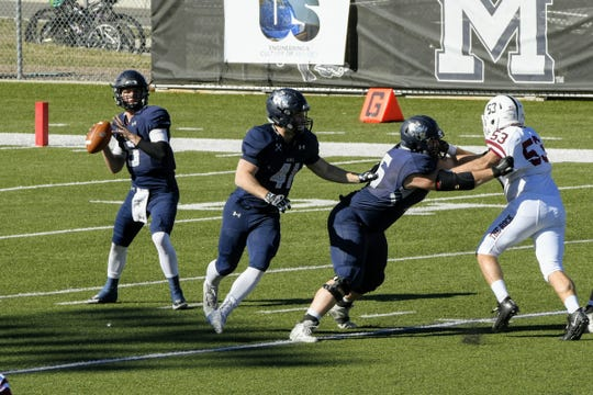 Isaac Harker (5) drops back to pass for Colorado School of the Mines.