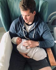 RTV6 new anchor Lauren Casey's husband Brooks holds their newborn son Archer Vincent.