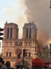 Smoke filled  the air as the iconic Notre Dame burned for hours Monday.