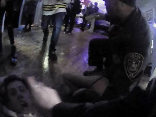 Video still of Goldstein being pepper sprayed while handcuffed.