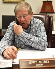 Jerry Autrey, mayor of Batesville, Miss. speaks on the phone in his office.
