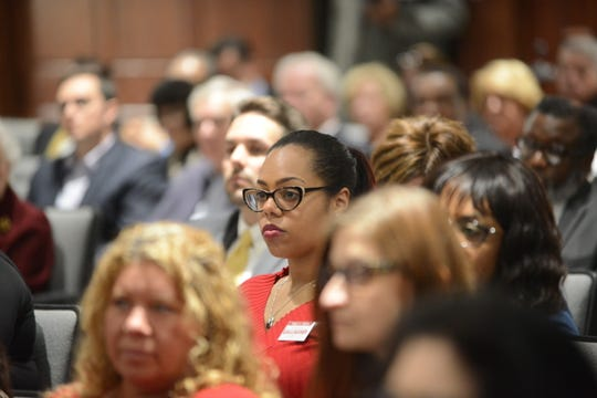 Christiana Gallagher listens during the April city council meeting in Jackson, Tenn.