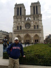 West Tennessean Josh Lemons stands outside the iconic towers of the Notre Dame Cathedral in Paris in 2011.