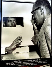 Student Bob Booker talks to Knoxville College Dean John Bell from a city jail cell after Booker's arrest during a protest at the Tennessee Theater on October 9, 1961.