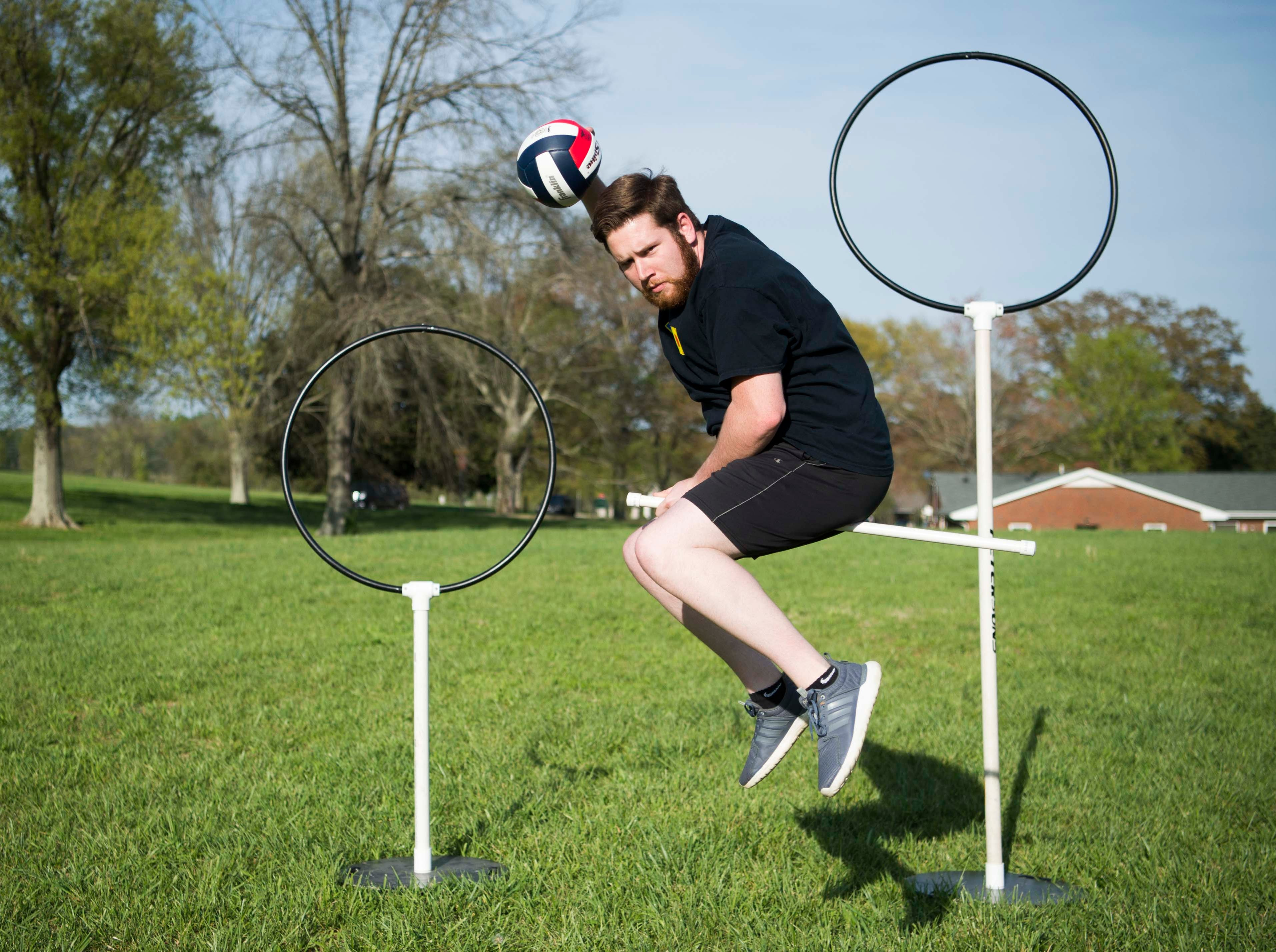 News Sentinel reporter Ryan Willusz poses for a photo on his broom before Knoxville Summer Quidditch League practice at Lakeshore Park in West Knoxville  Thursday, April 11, 2019.