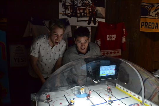 Play a game of bubble hockey at Suttree's High Gravity Tavern.