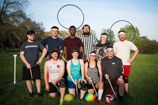 Members of the Knoxville Summer Quidditch League pose for a photo at practice at Lakeshore Park in West Knoxville Thursday, April 11, 2019.