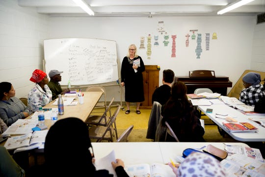 Christy Tefft teaches a level three English class to refugees at the Center for English inside West Lonsdale Baptist Church in Knoxville, Tennessee on Monday, April 15, 2019. Run by a handful of unpaid volunteers with no grant funding and a budget patched together by community goodwill donations, the center serves over 200 refugees to teach them English and American customs inside a space provided to them by the church.