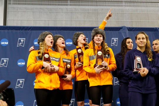From left, Nikol Popov, Meghan Small, Madeline Banic and Erika Brown of Tennessee celebrate after winning the 200 medley relay at the NCAA women's swimming championship in Austin, Texas, on March 22.