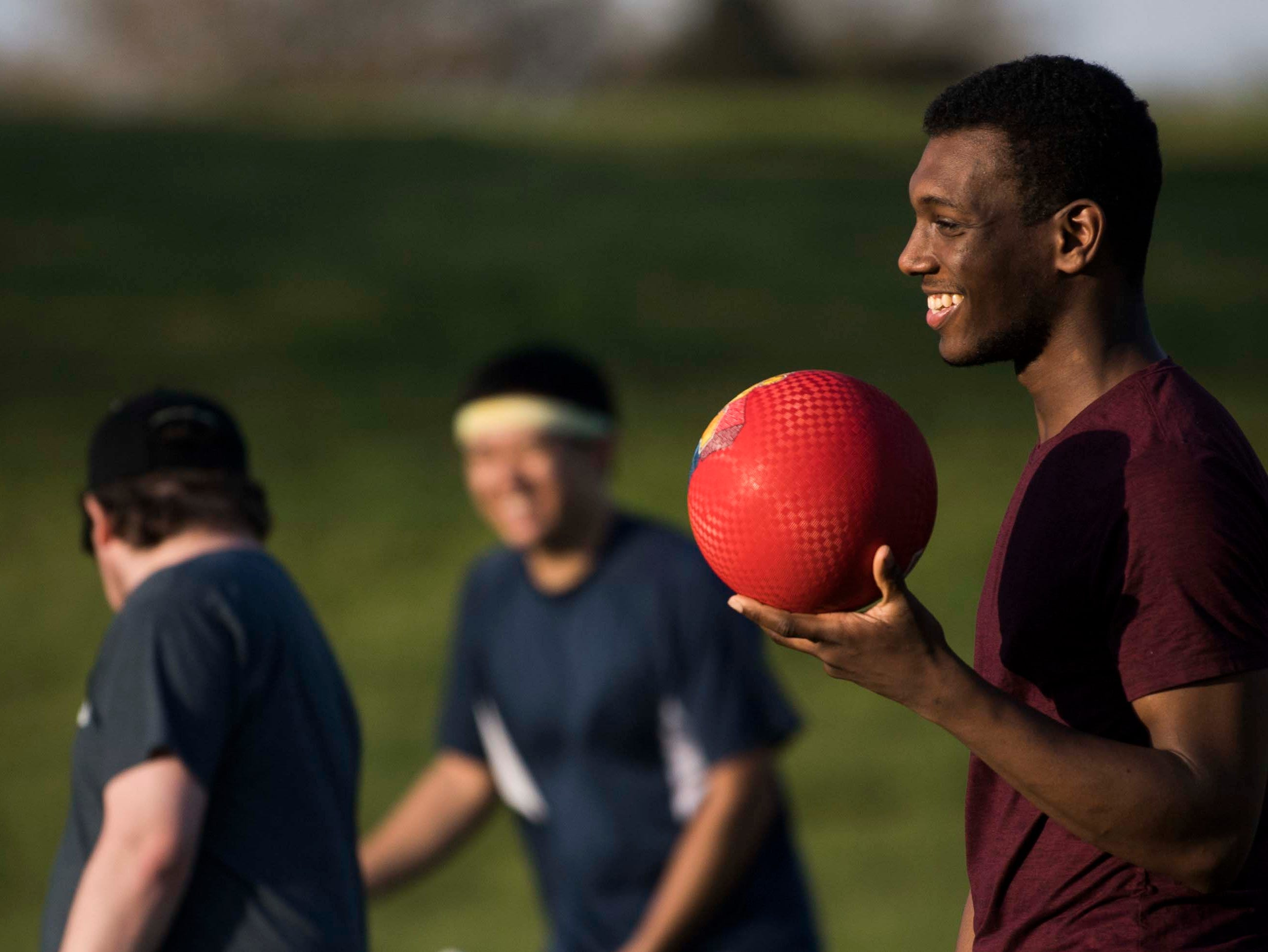 At right  Johnathan Lee  practices with the Knoxville Summer Quidditch League at Lakeshore Park in West Knoxville Thursday, April 11, 2019.