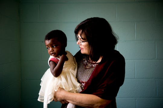 Deni Kidd holds a three-year-old refugee girl from Congo at the Center for English inside West Lonsdale Baptist Church in Knoxville, Tennessee on Monday, April 15, 2019. Run by a handful of unpaid volunteers with no grant funding and a budget patched together by community goodwill donations, the center serves over 200 refugees to teach them English and American customs inside a space provided to them by the church.