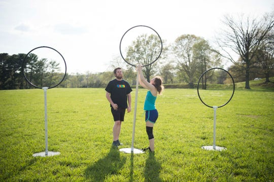 News Sentinel reporter Ryan Willusz and Maggie Loveday, commissioner of the Knoxville Summer Quidditch League and the Mid-South Quidditch Conference, set up equipment for practice at Lakeshore Park in West Knoxville Thursday, April 11, 2019.