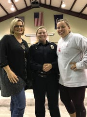 Abbeville Officer Kaitlyn Rudesill, center, with her mother, left, and sister Danielle.