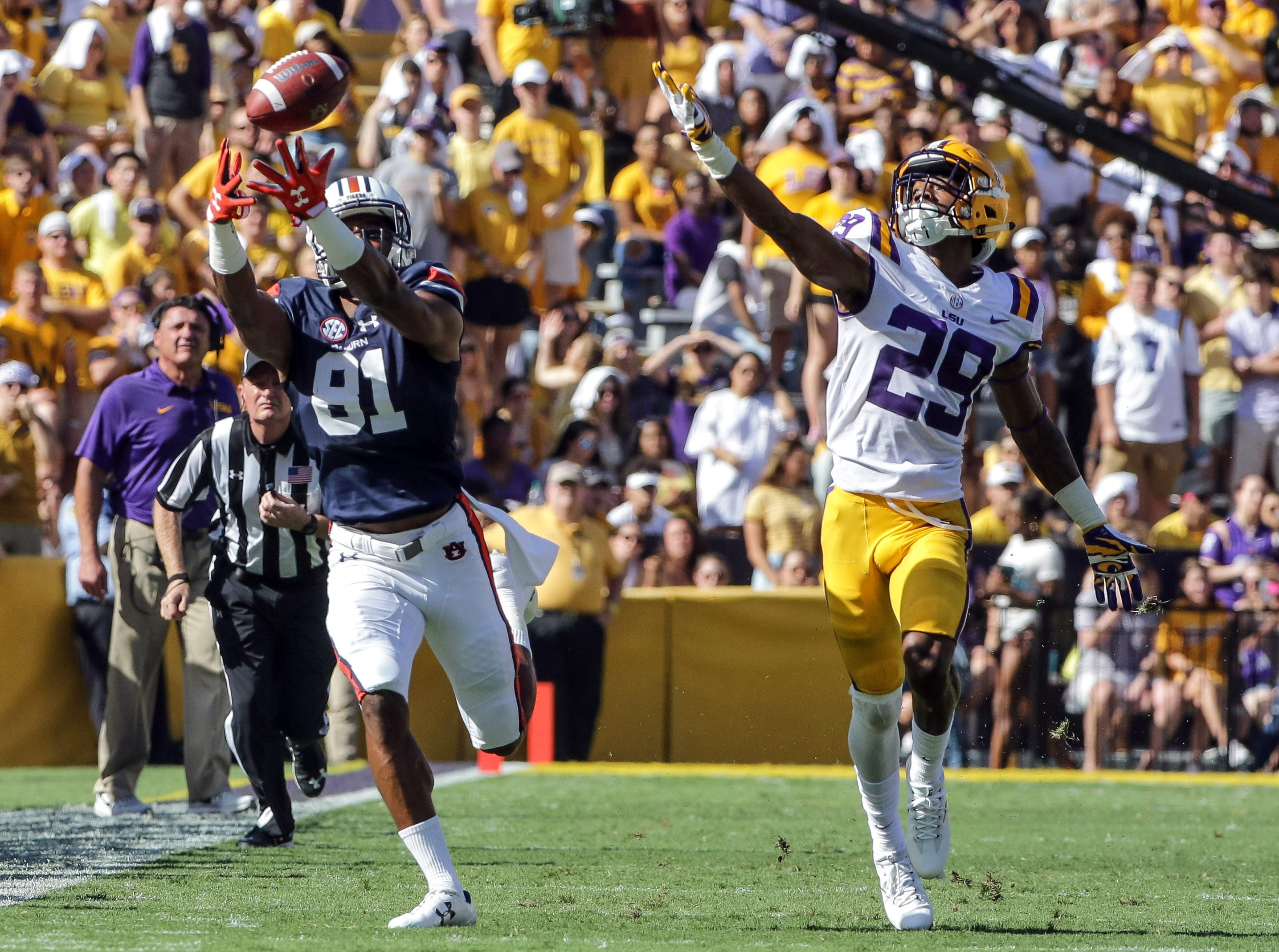 Oct 14, 2017; Baton Rouge, LA, USA; Auburn Tigers wide receiver Darius Slayton (81) catches a pass over LSU Tigers cornerback Andraez Williams (29) during the first half of a game at Tiger Stadium. Mandatory Credit: Derick E. Hingle-USA TODAY Sports