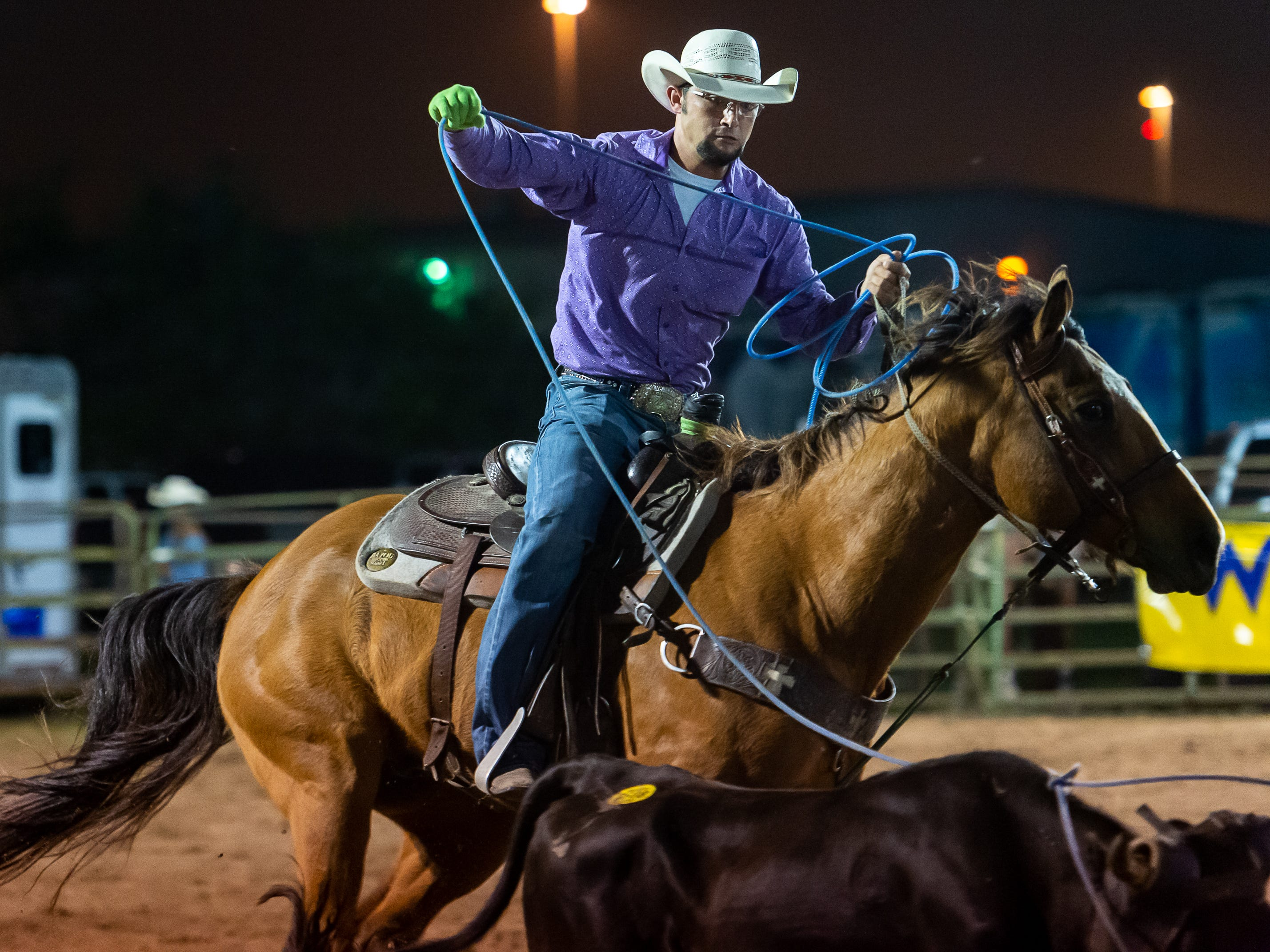 Tyler Geheb competses in the team roping event as the Cajun Rodeo Association host the Cowboys Spring Stampede 19 Rodeo at Cowboys Arena in Scott, LA. Saturday, April 13, 2019.